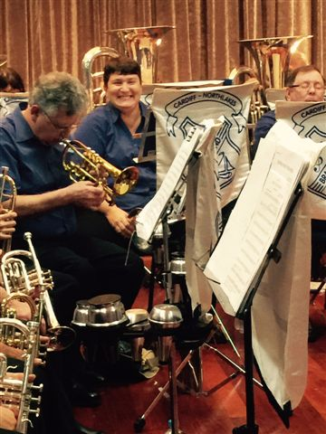 Alison Tonkin, solo horn, is amused at the Movie Magic Concert 20 September 2015.