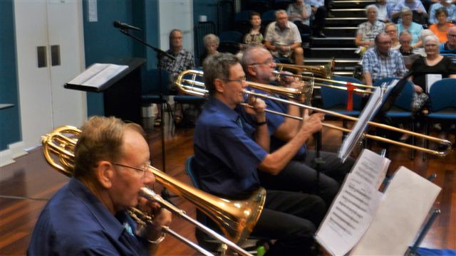 """Trombonists Arthur. Joe and Marcus """"slide into the rhythm"""" at the Christmas in Brass Concert. 18 December 2016"""